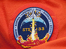 The STS-133 mission patch.