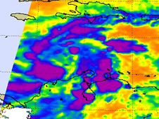 Remaining strong, high thunderstorm cloud tops (purple) appear scattered around the depression's center of circulation.