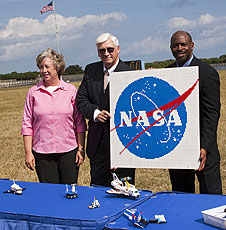 Melvin and Turnipseed hold a LEGO NASA logo.