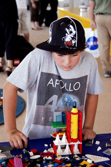Tanner builds a LEGO rocket.