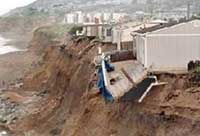 Coastal erosion threatens nearby structures