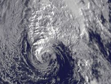 Tomas' remnants are the tight swirl of clouds at the bottom of that line of clouds (near Bermuda).