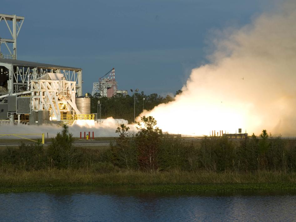 NASA's John C. Stennis Space Center in Mississippi conducted a successful test firing on Wed., Nov 10, 2010 of the liquid-fuel AJ26 engine that will power the first stage of Orbital Sciences Corp.'s Taurus II space launch vehicle. Orbital and its engine supplier, Aerojet, test-fired the engine on Stennis' E-1 test stand. The test directly supports NASA's partnerships to enable commercial cargo flights to the International Space Station. The initial test, the first in a series of three firings, lasted 10 seconds and served as a short-duration readiness firing to verify AJ26 engine start and shutdown sequences, E-1 test stand operations, and ground-test engine controls. Credit: NASA