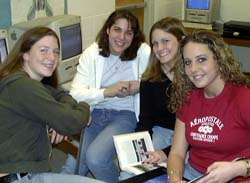 picture of four teenage girls in computer lab
