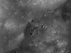 Boulders and simple craters perched on top of Kepler crater's central peak