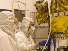 Engineers inspect Glory in a clean room at Orbital.