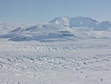 Mt. Murphy breaks the monotony of the mostly flat and barren white landscape of West Antarctica