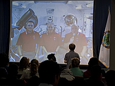 A group of students talking with crew members on the space station