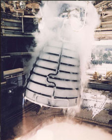 A space shuttle main engine fires in test stand.