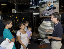 Brent Bos talks with guests at the Goddard Visitor Center