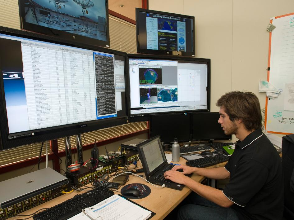 Anthony Young works in the Mission Operations Center at Santa Clara University, Santa Clara, Calif., in support of NASA's Organism/Organic Exposure to Orbital Stresses (O/OREOS)
