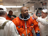 Closeout Crew members assist astronaut Leland Melvin before launch.