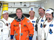 STS-114 Mission Specialist Steve Robinson poses with part of the Closeout Crew.