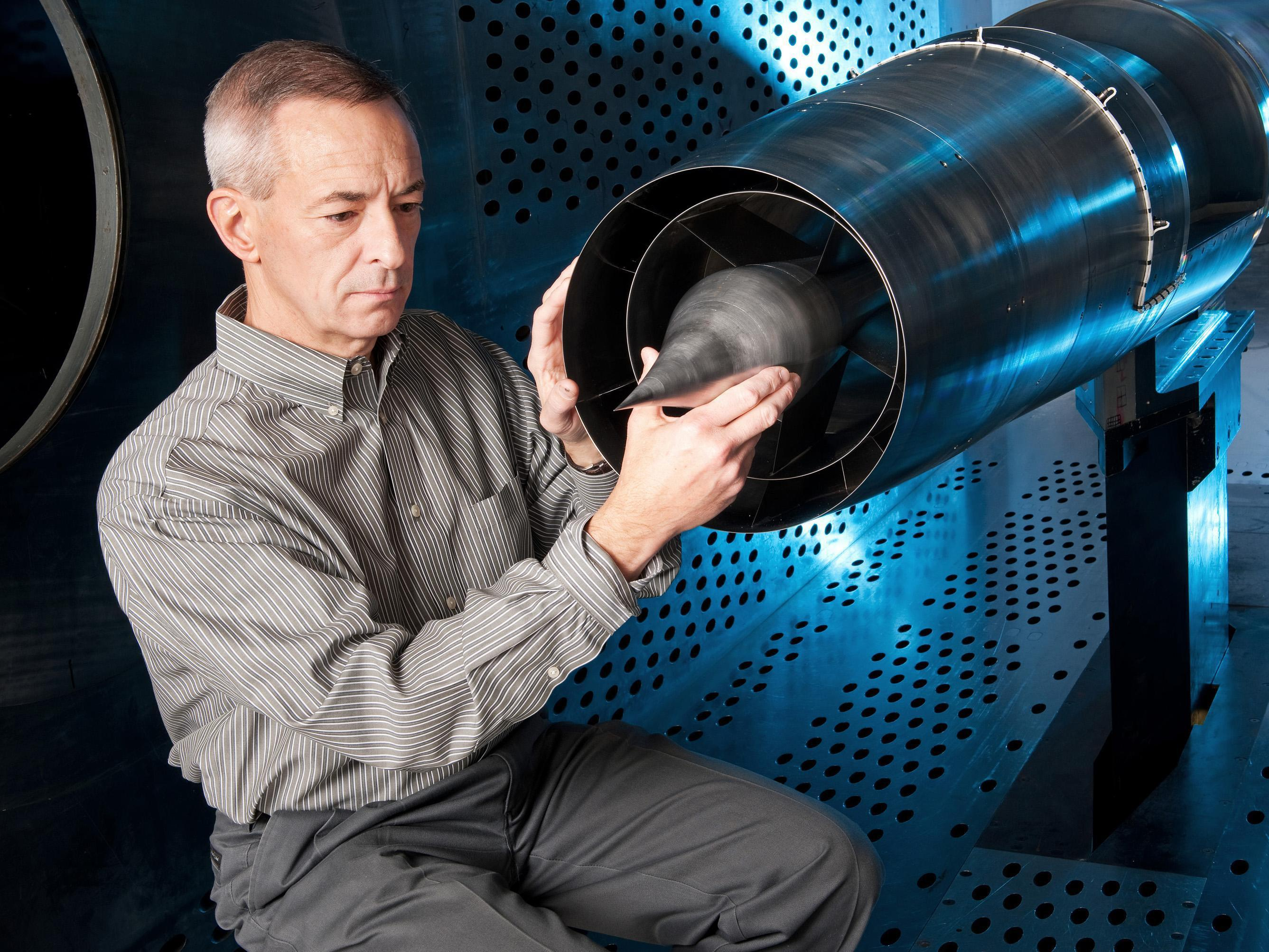 Rod Chima, a NASA aerospace engineer, is pictured here in the wind tunnel with the Large-Scale Low-Boom supersonic inlet model.