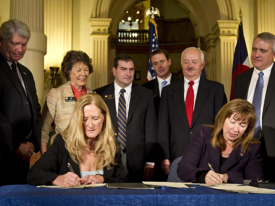 Colorado Association for Manufacturing and Technology (CAMT) CEO Elaine Thorndike, seated left, and NASA Deputy Administrator Lori Garver, seated right, sign an agreement at the Colorado State Capitol in Denver on Monday, Dec. 13, 2010, that created a Technology Acceleration Program and Regional Innovation Cluster for Aerospace and Clean Energy. Looking on from left, Executive Director, Colorado Office of Economic Development and International Trade Don Marostica, Colorado State Representative Su Ryden, Colorado State Senate President Brandon Schaffer, Representative from U.S. Senator Udall's office Jimmy Haugue, NIST/MEP Director Roger Kilmer and Colorado State Governor Bill Ritter.