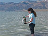 Geomicrobiologist Felisa Wolfe-Simon collecting lake-bottom sediments