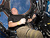 Commander Scott Kelly in the space station Cupola