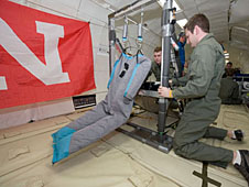 Students working with an experiment in a reduced-gravity aircraft