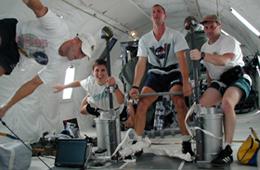 Photo of exercise test subjects floating on a zero-g parabolic plane flight.