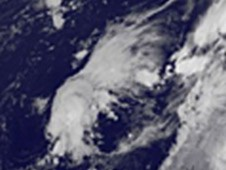 Tropical Storm Omeka to the west of a stream of clouds (along a front) in the Pacific.