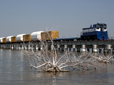 The NASA Railroad train transports solid rocket booster segments over the Indian River