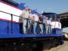 The NASA Railroad Maintenance Crew and Railroad and Transportation Management Team beside NASA Railroad locomotive 3