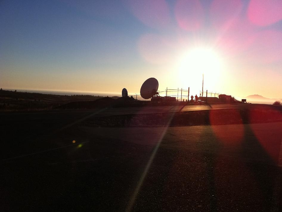 Ground station satellite dishes at sunset located at the Alaska Aerospace Corporation's Kodiak Launch Complex.