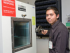 Gilbert Castillo operates a piece of laboratory equipment
