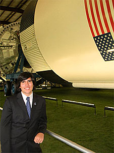 Lopez with a Saturn V rocket