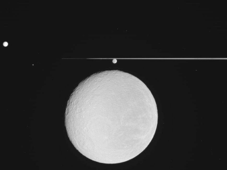 raw image of Saturn's icy moon Rhea in the foreground
