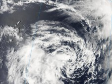 MODIS captured a visible image that shows the bulk of the thunderstorms southwest of Vince's center.
