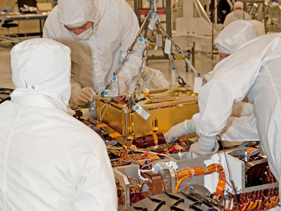 Lowering SAM instrument into Curiosity Mars rover