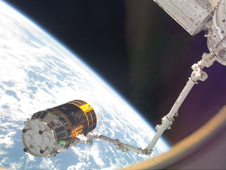 iss021e017065 -- Canadarm2 grapples the H-II Transfer Vehicle