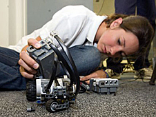 Erin Meekhof working on a small robot