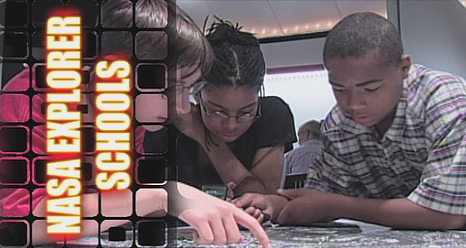 A group of students looking at something with the words NASA Explorer Schools to the side