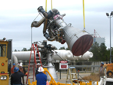 Stennis Space Center employees monitor the lifting of the first Aerojet AJ26 flight engine at the E-1 Test Stand onsite. Credit: NASA