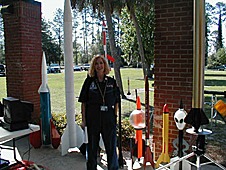 Kearns stands with a collection of model rockets