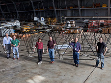 Team poses with truss assembly