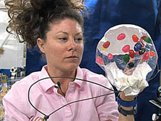 Woman with experiments aboard the International Space Station