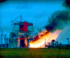 Smoke and flames belch from the S-1C test stand during static firing of the Apollo/Saturn V first-stage booster
