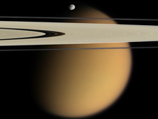 Titan seen behind Saturn's rings