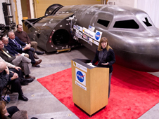 NASA Deputy Administrator Lori Garver talks during a press conference with Sierra Nevada's Dream Chaser spacecraft in the background on Saturday, Feb. 5, 2011, at the University of Colorado at Boulder.