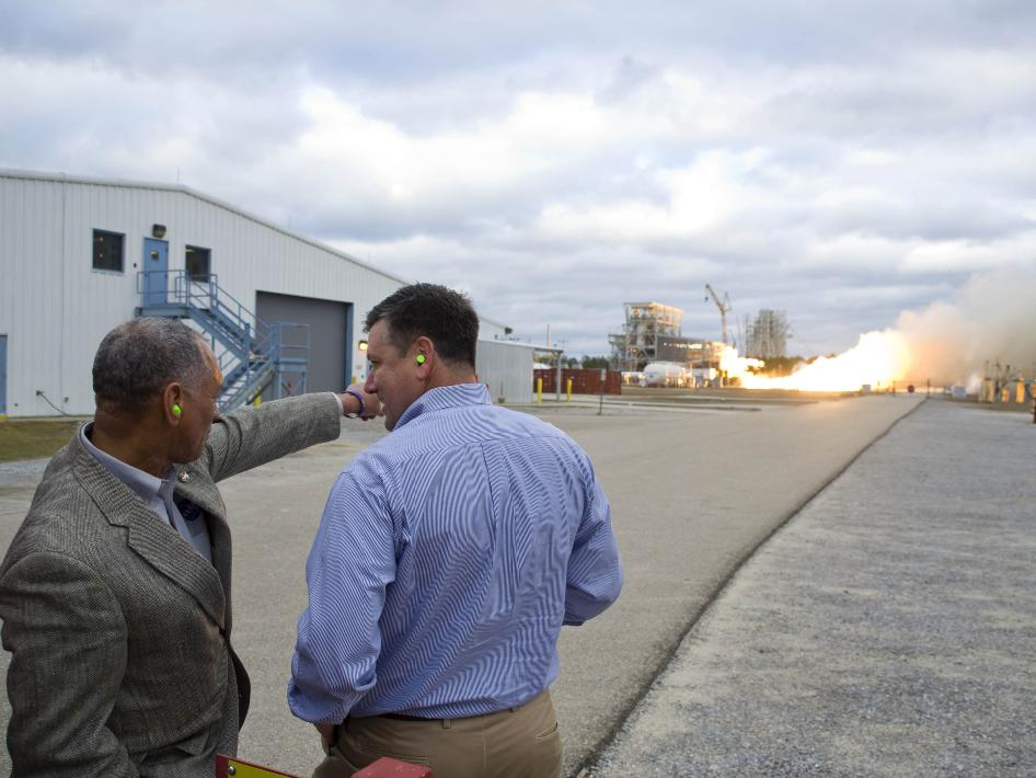 NASA Administrator Charlie Bolden (left) and Stennis Space Center Director Patrick Scheuermann view a test firing of the first Aerojet AJ26 flight engine.
