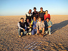 A group of people in the desert