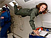 Emily Calendrelli smiles as she floats aboard an airplane
