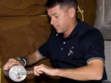 Astronaut Shane Kimbrough works on a space microgravity bacteria virulence experiment.