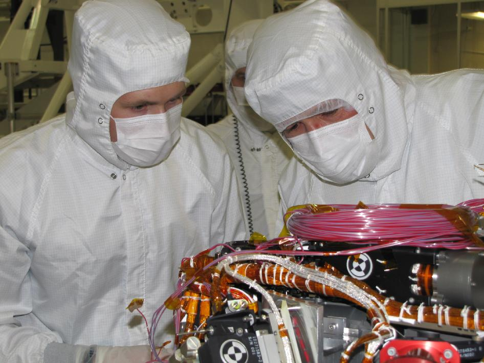 Grad student Nicholas Boyd (left) and Principal Investigator Ralf Gellert with Alpha Particle X-ray Spectrometer