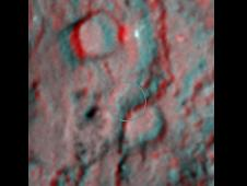 3-D image, or anaglyph, shows the region where NASA's Deep Impact mission sent a probe into the surface of comet Tempel 1