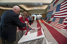 Kennedy's Joe Dowdy stitches the National 9/11 Flag.