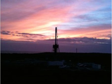 The sun sets over Vandenberg Air Force Base behind the Taurus XL launch vehicle that will propel Glory into space.